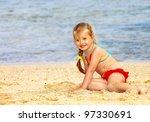 little girl  playing on  beach. | Shutterstock . vector #97330691