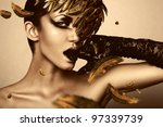 woman with black glove and gold feather - stock photo