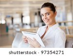 happy young woman using tablet... | Shutterstock . vector #97354271