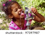 Adorable Child Drinking From...