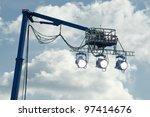 high powered spotlights illuminating an outdoor movie set - stock photo