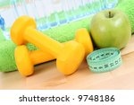 dumbbells towel and green apple