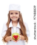 An apple a day keeps the doctor away - little girl in nurse outfit offering apple - stock photo