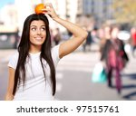 portrait of young woman holding ... | Shutterstock . vector #97515761