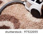 vacuum cleaner on brown carpet | Shutterstock . vector #97522055