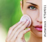 young woman closeup applying... | Shutterstock . vector #97569011