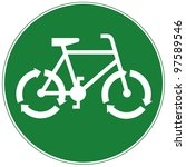 Green road sign with white bicycle pictogram with three-arrow recycle symbol as wheels - recycle concept - stock photo