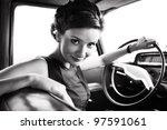 Stock photo beautiful lady sitting in a retro car 97591061