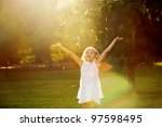 girl playing in the sun | Shutterstock . vector #97598495