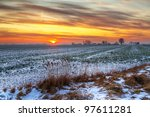 Idyllic sunset over snowy meadow in Poland - stock photo