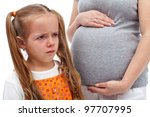 I don't want a little brother - crying little girl with pregnant mother - stock photo