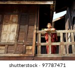 SHAN STATE, MYANMAR - NOV 22: unidentified young monks at the old teak wood Shwe Yan Pyay Monastery, this famous monastery was built by ancient Shan kings on Nov 22, 2011 Shan State, Myanmar - stock photo