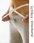 woman standing pulling... | Shutterstock . vector #9782275