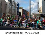LIMERICK, IRELAND - MARCH 17: Unidentified people watching parade for St. Patrick's Day. It's a traditional Irish holiday celebration. March 17, 2012 in Limerick, Ireland. - stock photo