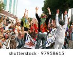 LIMASSOL, CYPRUS - MARCH 6, 2011: Unidentified participants  in hippie costumes during the carnival parade, established in 16th century, influenced by Venetian traditions - stock photo