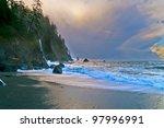 Big rocks and crushing waves against sun rising sky - la push beach forks washington