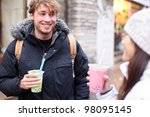 Friends in city drinking bubble tea / pearl milk tea smiling happy and talking in chinatown of Montreal, Quebec, Canada. - stock photo