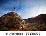 A Climber Hiker Stands Atop...