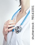 Female doctor holding stethoscope, close-up. Unrecognizable person - stock photo