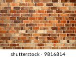 Multicolored red brick wall background. - stock photo