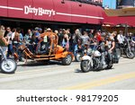 "DAYTONA BEACH, FL - MARCH 17:  Customized motorcycles line Main Street amid the sea of bikers in town for ""Bike Week 2012"" in Daytona Beach, Florida. March 17, 2012 - stock photo"