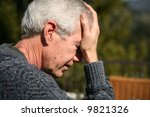 a well dressed man suffers from a headache - stock photo