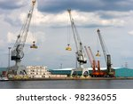 View on Antwerp port with containers to be shipped worldwide  - all logos and brand names removed - stock photo