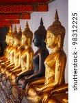 sitting buddha statues in...
