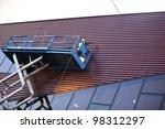 Builder On A Scissor Lift...