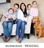 Stock photo big family at home with a dog all looking very happy 98332361