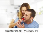happy young couple eating... | Shutterstock . vector #98350244