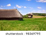 Beautiful village landscape with wooden houses and windmills - stock photo
