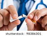 Doctor Breaking A Cigarette
