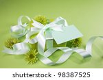 gift box with flowers on green... | Shutterstock . vector #98387525