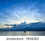 distant storm at sunset | Shutterstock . vector #9846583