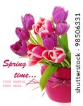 bunch of fresh pink and purple tulips in vase against  white background - stock photo