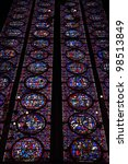 colorful stained glass in gothic Catholic church - stock photo