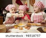 Three Little Chefs Enjoying In...