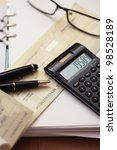 calculator and paper on an... | Shutterstock . vector #98528189