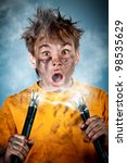 Electric shock sees a shocked boy - stock photo