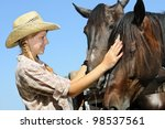 young cowgirl and two horses in ... | Shutterstock . vector #98537561