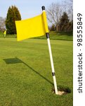 Yellow Golf Flag In Hole On...