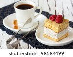 Delicious cake with fresh raspberries and cup of coffee. - stock photo