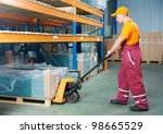 Worker With Fork Pallet Truck...
