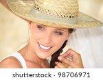pretty woman wearing straw hat   Shutterstock . vector #98706971