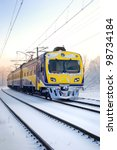 A City Train On Snow Covered...