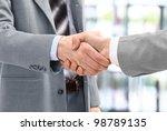 business men in a handshake at...   Shutterstock . vector #98789135