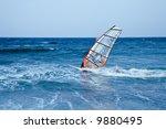 windsurfer sailing away form... | Shutterstock . vector #9880495
