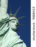 This is a diagonal profile of the statue of liberty. - stock photo