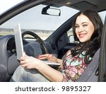 beauty woman with silver laptop sitting in the car - stock photo